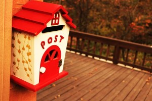 Red and white mailbox that says 'post' - when informing people about your relocation, notify the post office.