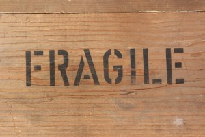 sign fragile on the wooden box