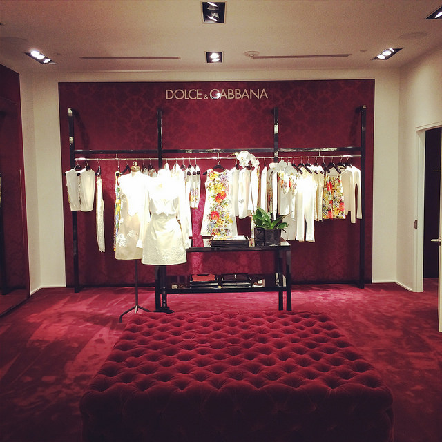 The Dolce & Gabbana stall is all burgundy velvet. Love the ottoman!