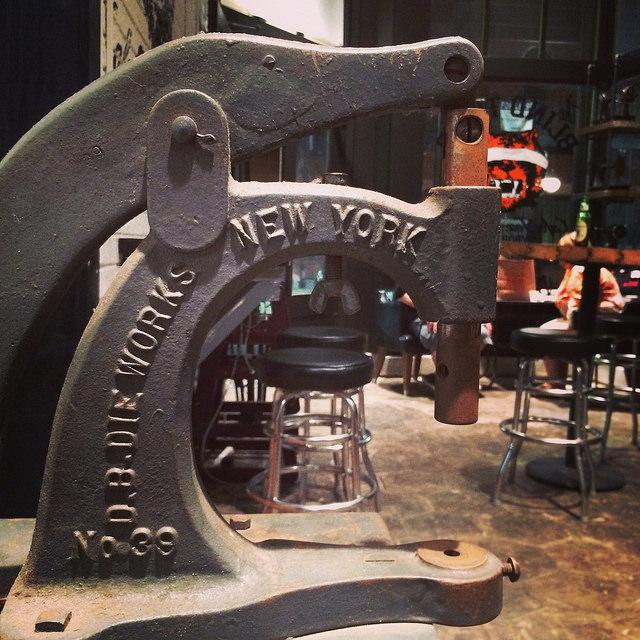 Antique rivet machine at the Blind Tiger Cafe