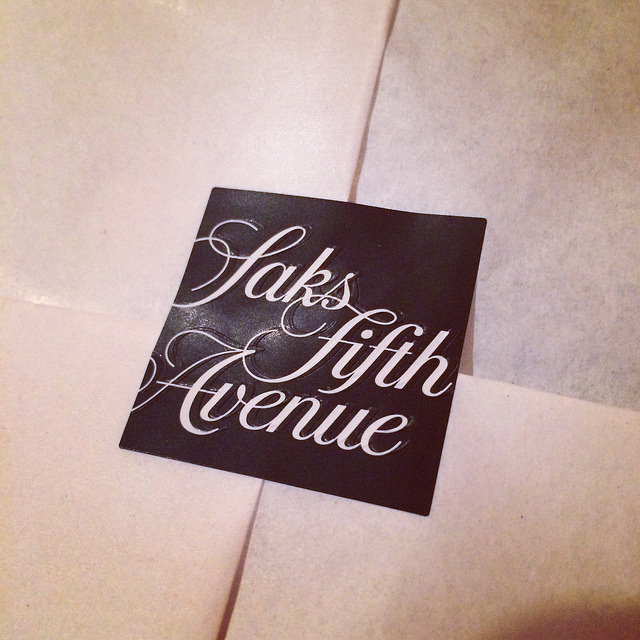Saks Fifth Avenue new branding, sticker securing tissue-wrapped package
