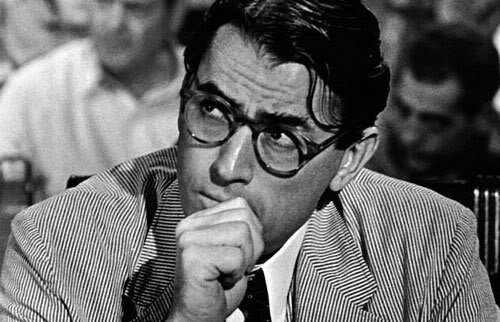 Atticus Finch aka Gregory Peck in small, rounded tortoise glasses