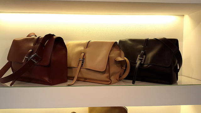 Men's leather satchels in brown, cream, and black