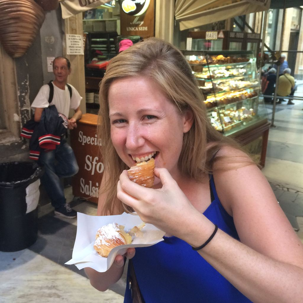 Lauren attempting to eat a sfogliatelle in Naples