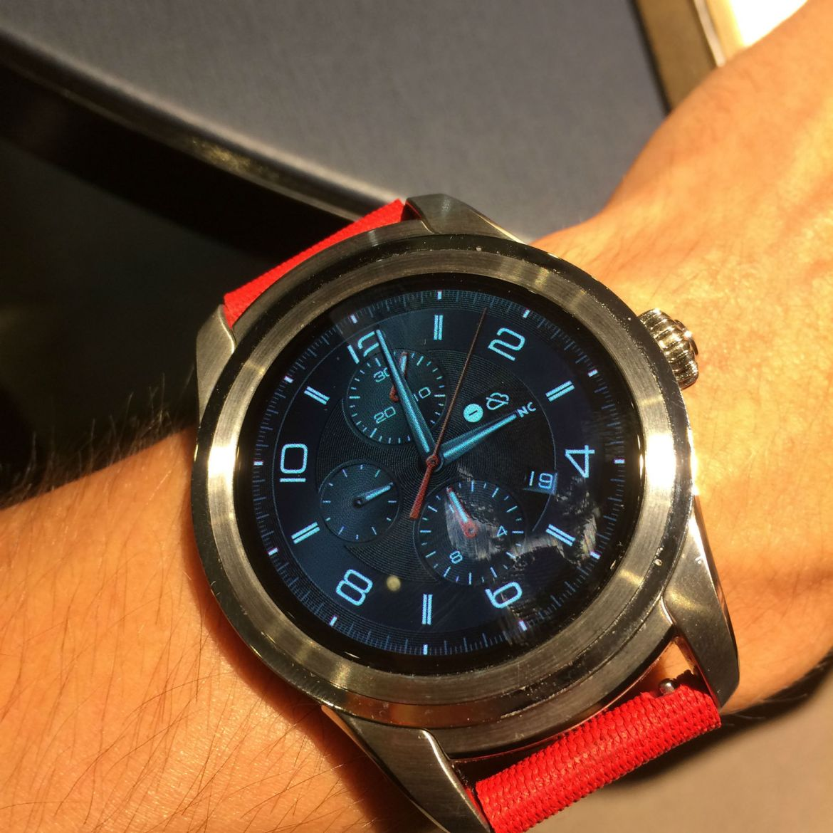 Montblanc Summit Smartwatch in polished stainless steel with red rubber strap and TimeWalker digital dial