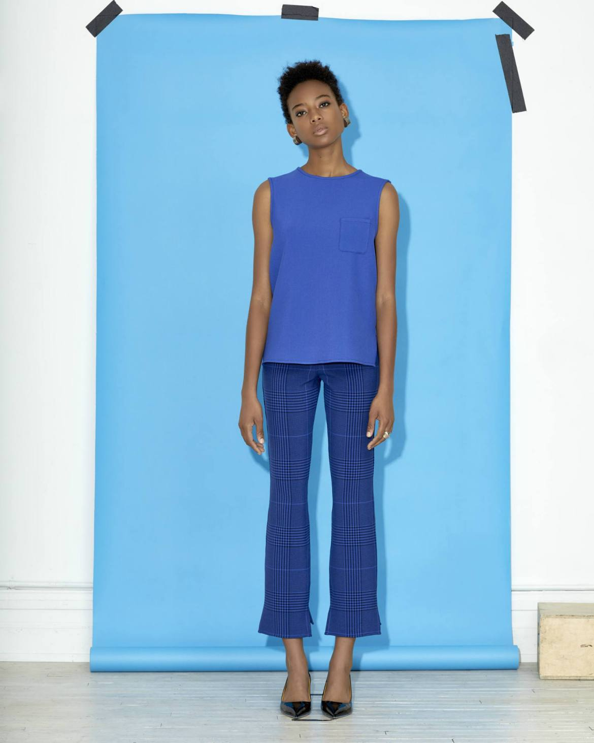 Argent Reversible Sleeveless Top in Electric Blue Navy. Reversible Trousers, meet the Reversible Sleeveless Top—a sleeveless, crew neck with side seam stepped-hem detailing. It's longer in the front than in the back. A top with a patch pocket and bright topstitching all around. Made from medium-heavy weight bonded fabric - same as the dress, trousers, and blazer. So, whether you're in the mood to match or you just want a killer top, you'll wear this tank out. Literally.