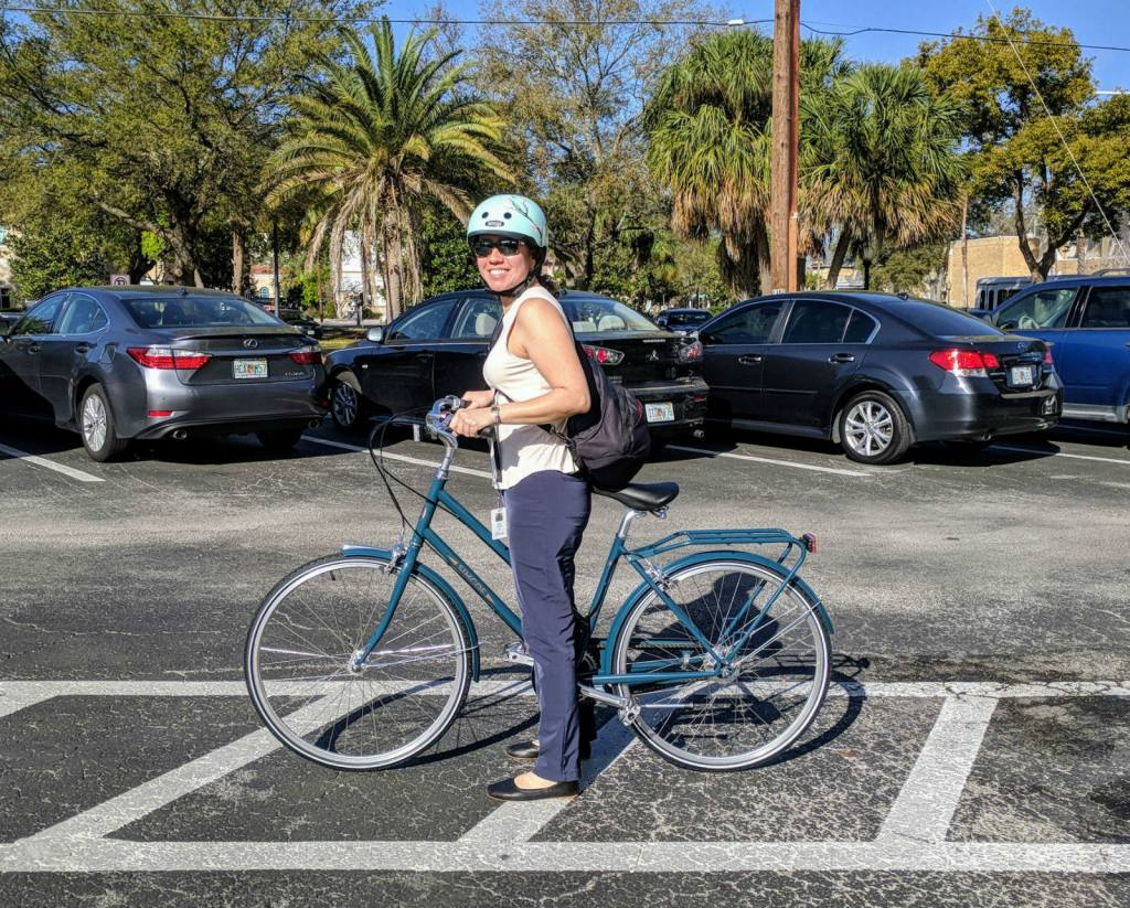 Tatiana G. biking to work in Ministry of Supply workwear
