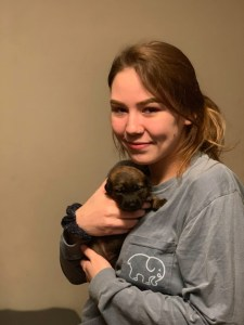 Caitlin Frangel holding puppy