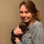 Caitlin Frangel holding puppy