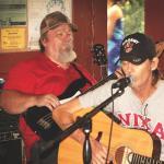 Rick A Cochran singing playing guitar