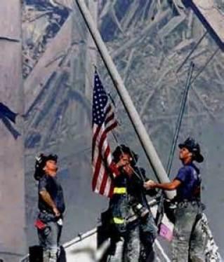 firemen raising flag