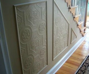 carved wainscoting with textured wallpaper feature