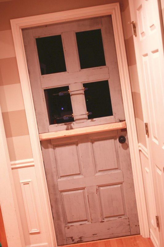 11 Remake an old used door into a dutch door with glass panels by Its the Little Things featured on @Remodelaholic