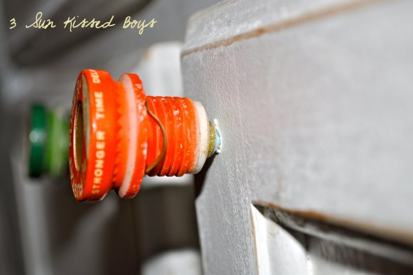 14 Fun, budget-friendly update to an all white kitchen using repurposed old fuses by 3 Sunkissed Boys featured on @Remodelaholic