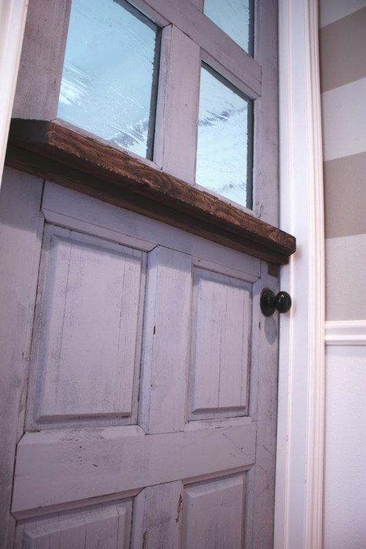 18 Reclaimed solid wood door DIY remodel into dutch door with glass panels by Its the Little Things featured on @Remodelaholic