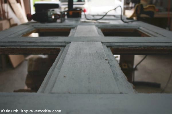 DIY Door Remodel Swapping Wood Panels For Glass By Its The Little Things Featured On @Remodelaholic 600x400