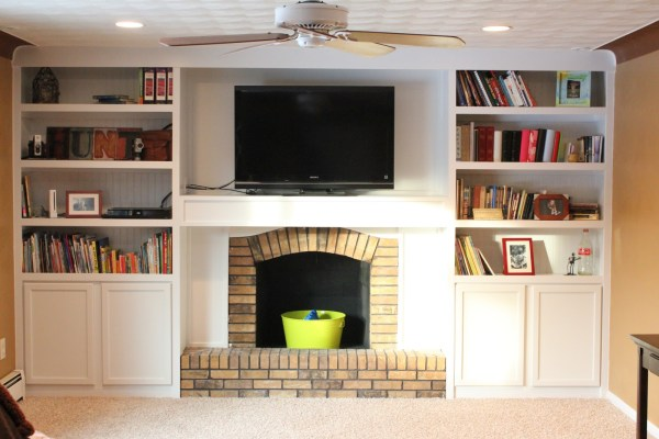 Remodelaholic 15 diy built in shelving ideas remodelaholic fireplace makeover with builtins made from stock cabinetry 1 solutioingenieria Image collections