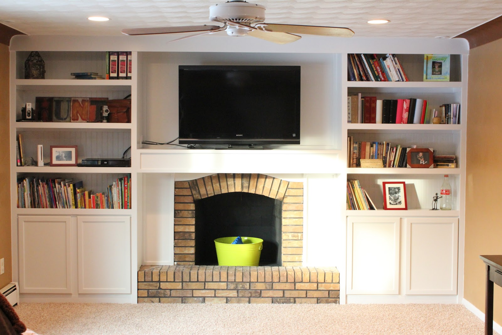 Exceptional Fireplace Makeover With Builtins Made From Stock Cabinetry (1)