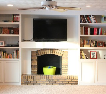 cabinets built in around a fireplace