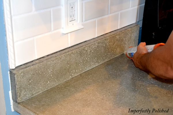Installing DIY Concrete Countertops And Molding, By Imperfectly Polished Featured On @Remodelaholic