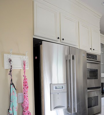 24 Transform your kitchen with paint and crown molding, by My Uncommon Slice of Suburbia featured on @Remodelaholic