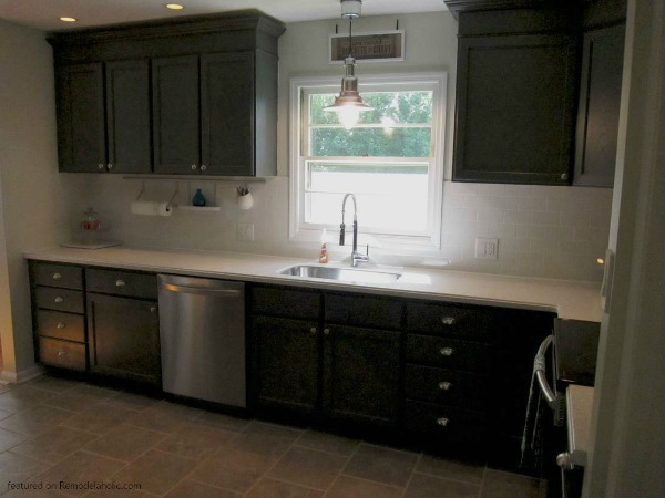 Updated Remodeled And Painted Charcoal Dark Grey Kitchen Cabinets In Sherwin Wiliams Peppercorn Gray And White Countertops, Featured On Remodelaholic