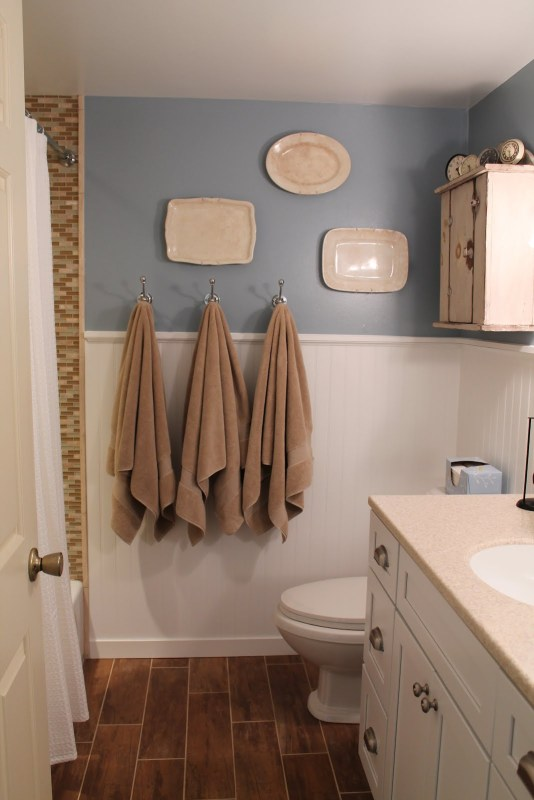 7 Complete remodel of bathroom, wood tiles for flooring, by Elizabeth and Co featured on @Remodelaholic