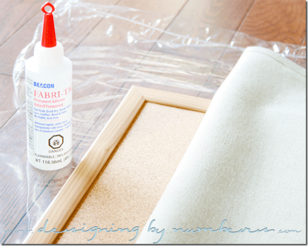 Apply glue along the corkboard against the frame's edge