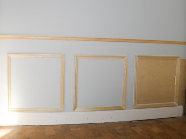 Hiding plumbing access with wainscoting-3