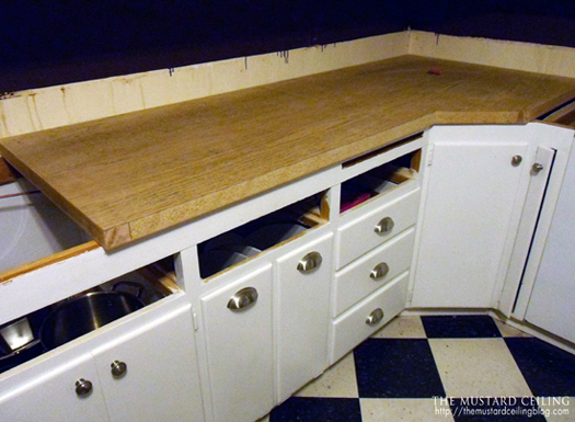 installing solid wood countertops made from old doors, The Mustard Ceiling on @Remodelaholic