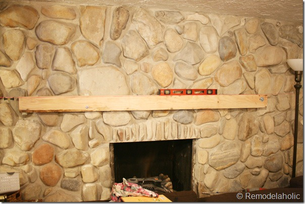Installing a wood mantel on a stone wall (20)