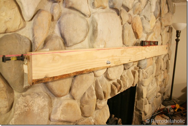 Installing a wood mantel on a stone wall (23)