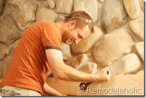 Installing a wood mantel on a stone wall (43)