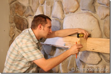Installing a wood mantel on a stone wall (44)