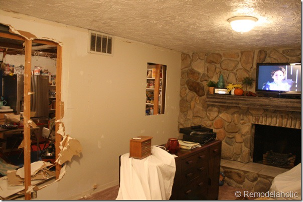 Installing a wood mantel on a stone wall (82)