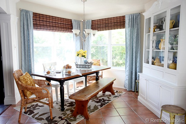 Dining-Room-updates-bamboo-shades-bench-wicker-chairs-white-hutch-blue-and-yellow-2.jpg