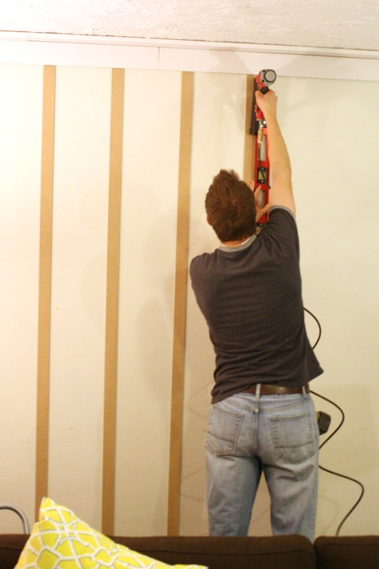 Follow this tutorial for installing board and batten floor to ceiling. From Remodelaholic.