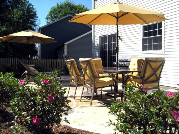 overhaul your backyard with a new landscape, patio, and furniture