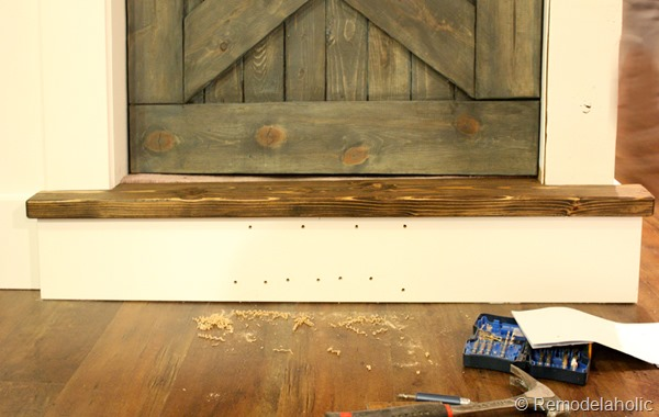 building out stair with wood bullnose and house numbers under barn door (13)