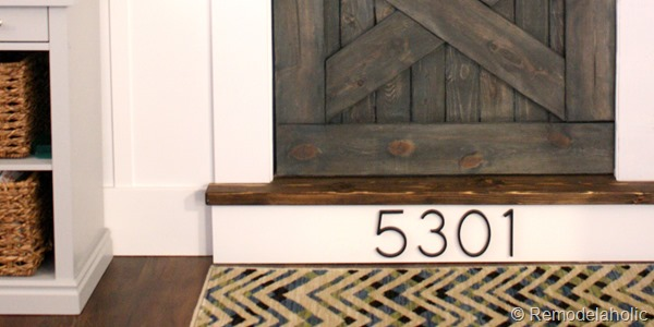 building out stair with wood bullnose and house numbers under barn door (16)