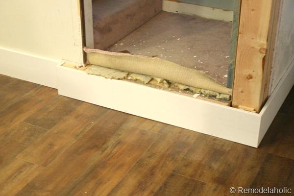 building out stair with wood bullnose and house numbers under barn door (2)