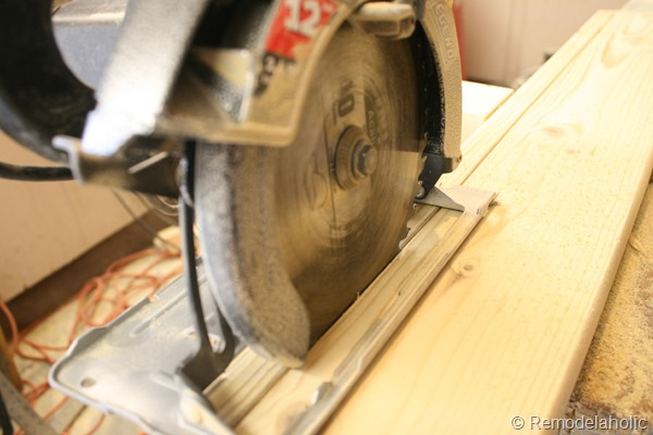 building out stair with wood bullnose and house numbers under barn door (4)