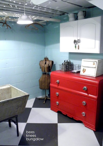 beautiful turquoise and red organized laundry room with storage