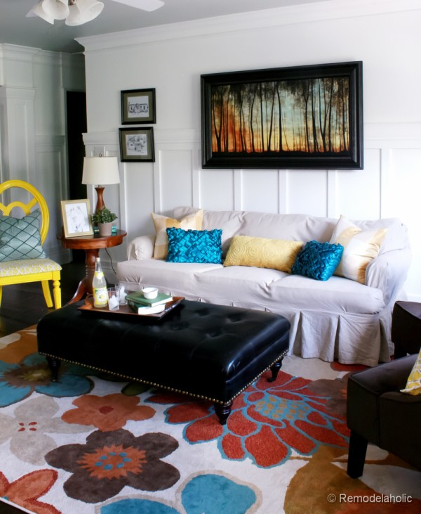 Living Room Remodel with yellow accents wood floors and built-in bookcases and columns with arches-14