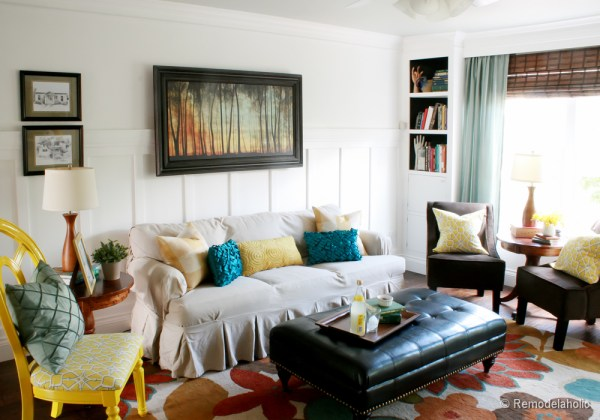 Living Room Remodel with yellow accents wood floors and built-in bookcases and columns with arches-16