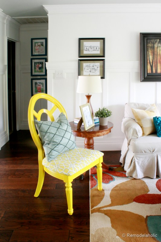 Living Room Remodel with yellow accents wood floors and built-in bookcases and columns with arches-19