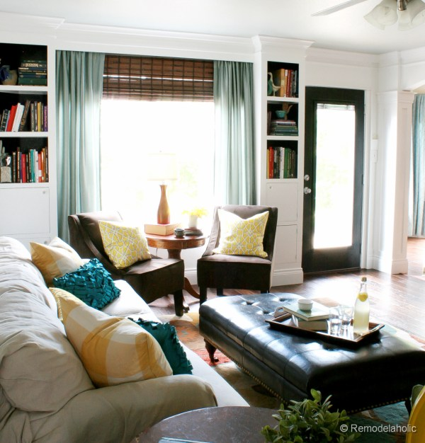 Living Room Remodel with yellow accents wood floors and built-in bookcases and columns with arches-37