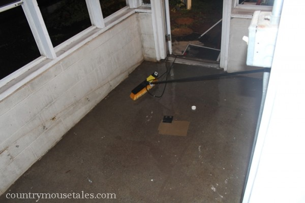 prepare a concrete floor for paint by scrubbing and etching