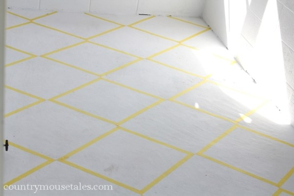 tape design to paint a concrete mudroom floor