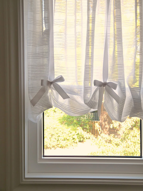 tension rod and ribbon curtains for awkward windows, Dans Le Townhouse